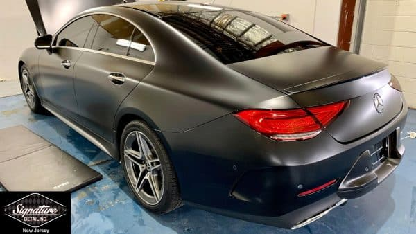 Signature Detailing New Jersey turns this Mercedes Sedan into a matte black with Clear Bra Paint Protection Film.
